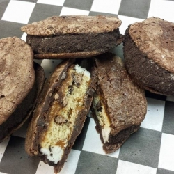 Brownie cookies stuffed with a chocolate chip cookie, caramel and buttercream rolled in crushed cookies. OMG yummy